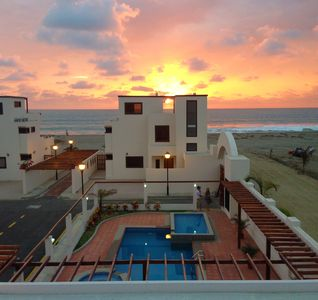 The view from your balcony at sunset, looking towards the beach