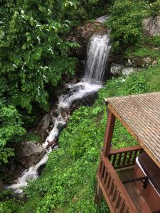 Waterfall close to authenticate log cabin