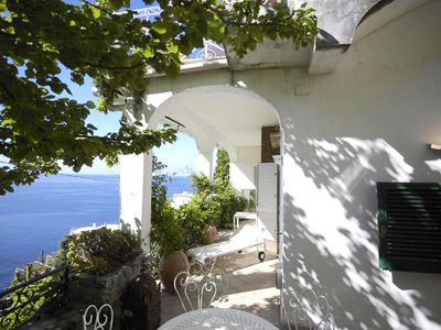 Photo for Spacious flat with fantastic views and private terrace and garden In Positano.