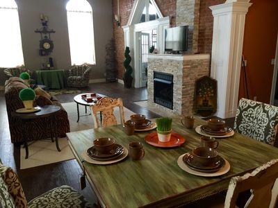 Large living area, 15 foot ceiling, large windows, exposed brick wall,