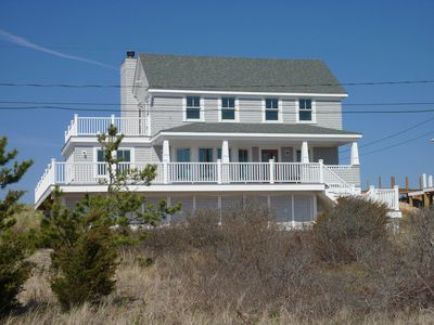 Front View of Home Showing Large Deck Area and covered porch