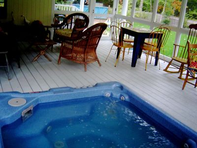 Jacuzzi all year! set in a screened porch