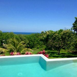 Photo for Tranquil Ocean-Views, Huge Sparkling Pool, Private Gated Dive Resort Community