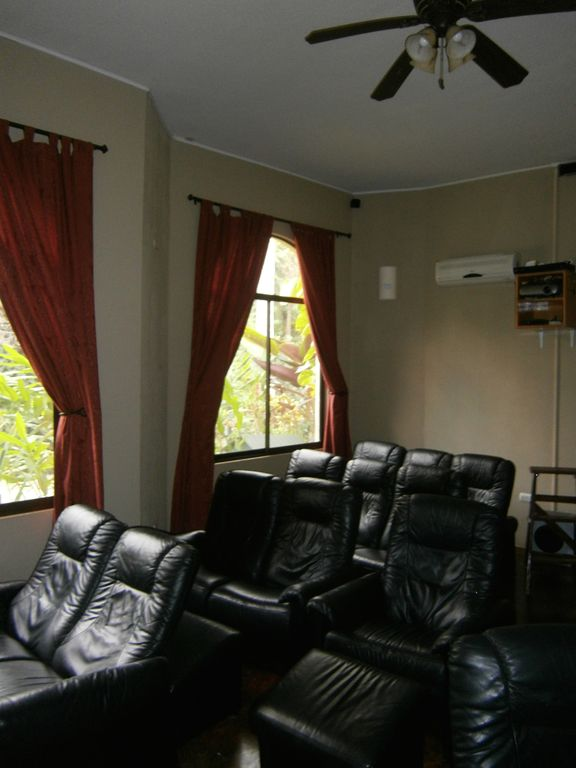 15 person cinema room / library with computer access