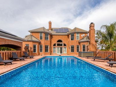 Photo for Expansive estate with a pool, hot tub, basketball court, wet bar & more!