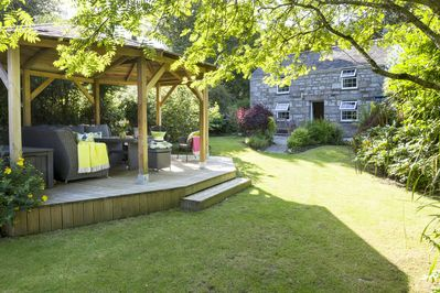 Enjoy Thornleigh garden from the gazebo with casual dining sofa's