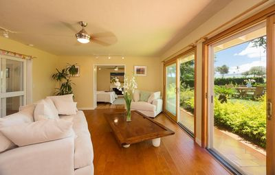 Living room with view golf course and mount Haleakala