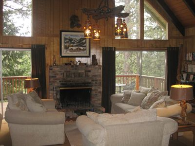 Cozy Living Room w/ large, comfy couches. Wood-burning fireplace w/ gas lighter.