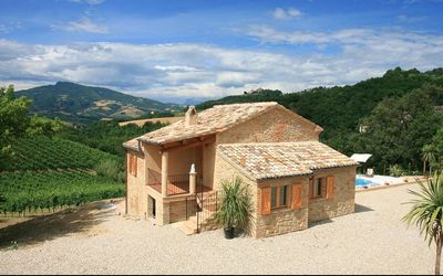 Photo for Spectacular views across the pool to mountains and historic village