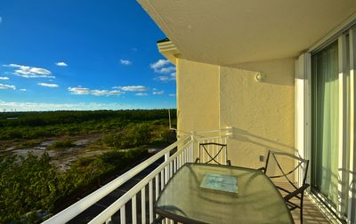 Photo for Watch sunsets from your deck! Shared pool/hot tub! Perfect for the whole family!