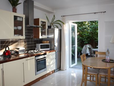 Photo for Luxury apartment, free parking, 2 bedrooms, private garden
