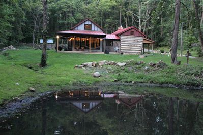 South facing view of cabin and pond