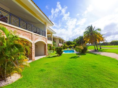 Photo for Fantastic tropical retreat! Green and secure Cocotal Residence with huge pools!