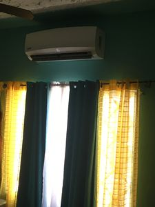 Air condition unit in bedroom with king size