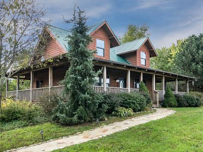 Photo for Mountain cabin with hot tub, mountain views, fire pit, and more! Includes Biltmore!
