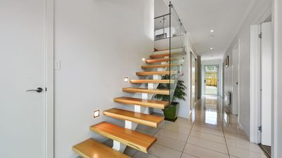Beautiful Tas Oak staircase with child safety gate at the top!