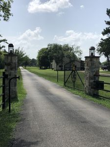 Gate and entrance from Rosehill Church Road. Long private driveway leads to home
