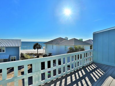 Photo for Steps Away from the beach! Amazing Location! Gulf views! Walk to the beach