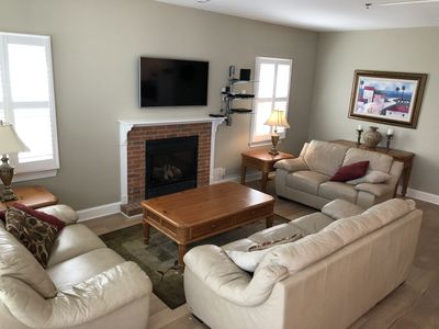 Living area with fireplace and high definition flat screen TV