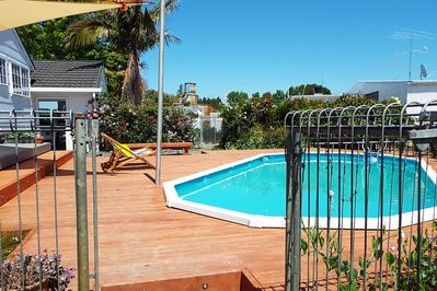 fenced swimming pool area