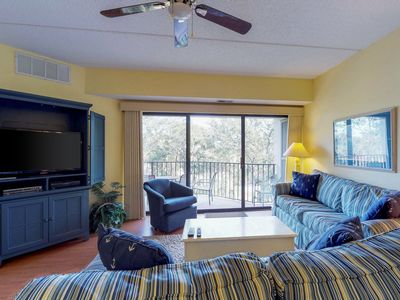 Photo for Modern, spacious condo w/ shared pool, tennis, private balcony, & beach access