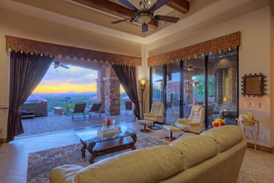 Elegant great room has pocket doors that open to back porch offering exceptional city and sunset views