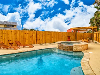 Photo for 3 bedroom 3 bath spacious home with beach access! Private Heated Pool!