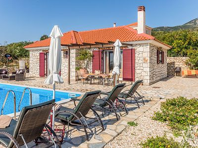 Photo for 2 bedroom villa with sea and country views. Close to restaurants and shops on foot and the beach a 5 minute drive. Countryside setting, peaceful and realxing, surrounded by greenery, orchards, fields and olive groves.Free Wi-fi, A/C, pool towels and hairdryers.