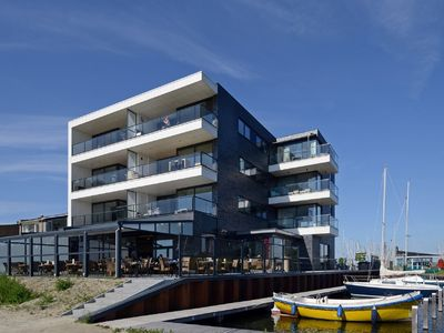 Photo for Modern apartment with balcony and magnificent view across the Veerse Meer lake