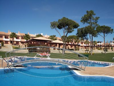 Photo for Townhouse Overlooking Pool and Gardens and facing Pestana Vila Sol Hotel.