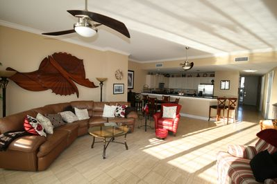 View of large living room, dining area and kitchen