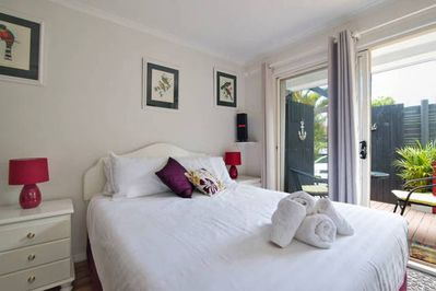 Comfortable queen bed with a view to the garden