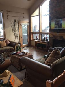 Open bright, comfortable, spacious family room with mountain views &  fireplace