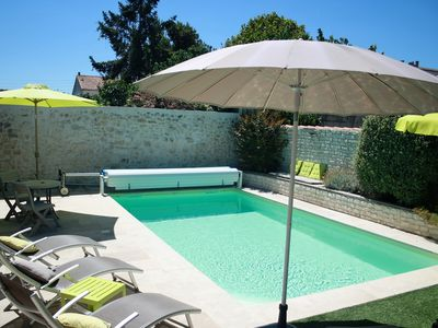 Photo for Typical and relaxing house with heated swimming pool near down town La Rochelle