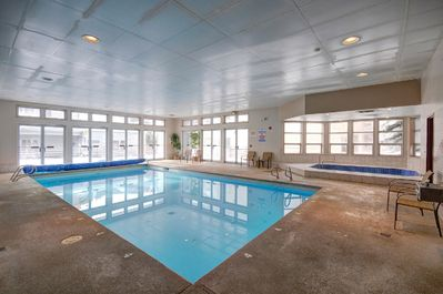 iftside Clubhouse with heated pool, large hot tub, and steam room.