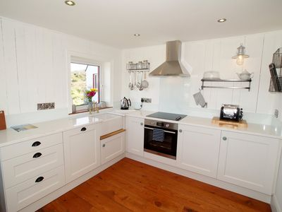 Photo for Stunning cottage inside and out with stunning views and right by the sea