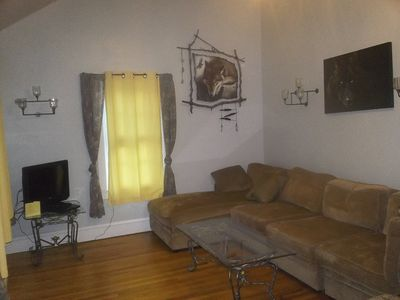 Spacious living room with broadcast tv and dvd player