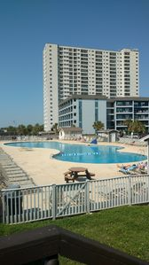 view of the pool and the condo from the beach