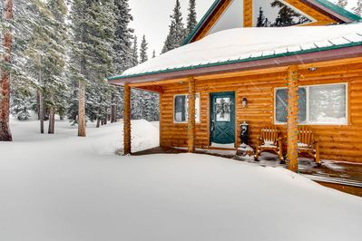 "Whimsical Hollow is a truly ""ROMANTIC"" log cabin nestled in the woods and high peaks of Park County!"