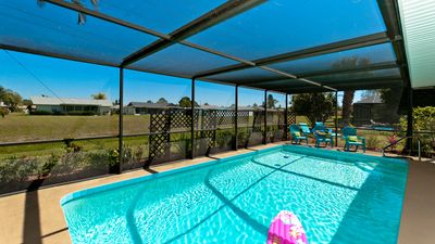 Photo for Endless Summer! Private Heated Pool, Just 10 Min to AMI Beaches or IMG Academy