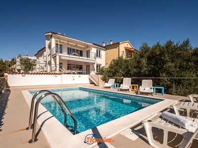 Photo for Villa with pool, 400 meters from the beach, sea views, surrounded by olive trees,