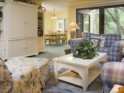 COMFORTABLE LIVING ROOM WITH LOVELY VIEW OF LAGOON AND GOLF COURSE. TV & DVDs.