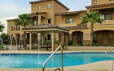 Photo for Luxury Townhome, Pool, Hot tub and is Gated. ** 3.5 miles from Alligiant Airport