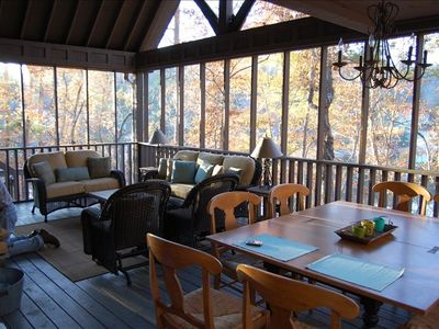 Dining table seats 10, water views from seating area that faces fireplace.