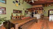 Is a spanish colonial house with a small pool in the center