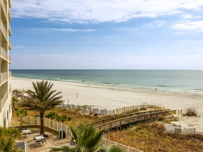 Photo for Breezy beachfront condo w/ access to shared pools, hot tub, sauna & gym!