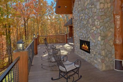 Cabin has several fireplaces including this outdoor fireplace avail. Year-Round
