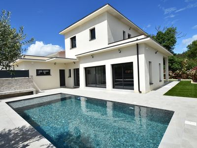 Photo for Modern villa with air conditioning, private swimming pool and fenced, flat garden with trampoline