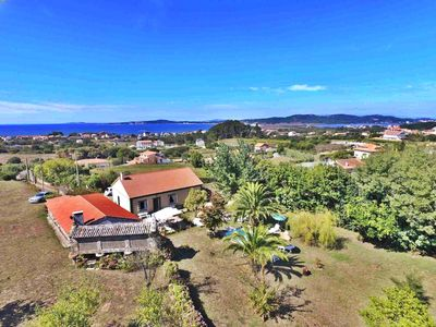 Photo for Beautiful, cozy holiday home with swimming pool near the beach