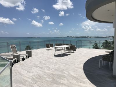 Photo for New Lux Beachfront Condo w Spectacular Views, Huge Private Deck, Pool, Gym